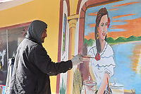 Juan Hernandez of Fort Smith paints a mural on the wall at Taqueria Don Guero in downtown Springdale. Hernandez has recently covered two walls at the business with new art. Visit nwaonline.com/200114Daily/ for today's photo gallery. (NWA Democrat-Gazette/J.T. Wampler)