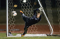 NWA Democrat-Gazette/BEN GOFF @NWABENGOFF<br /> Mason Smith, Fayetteville goalkeeper, tries to stop a Bentonville penalty kick in overtime Tuesday, March 13, 2018, during the match at Bentonville's Tiger Athletic Complex.