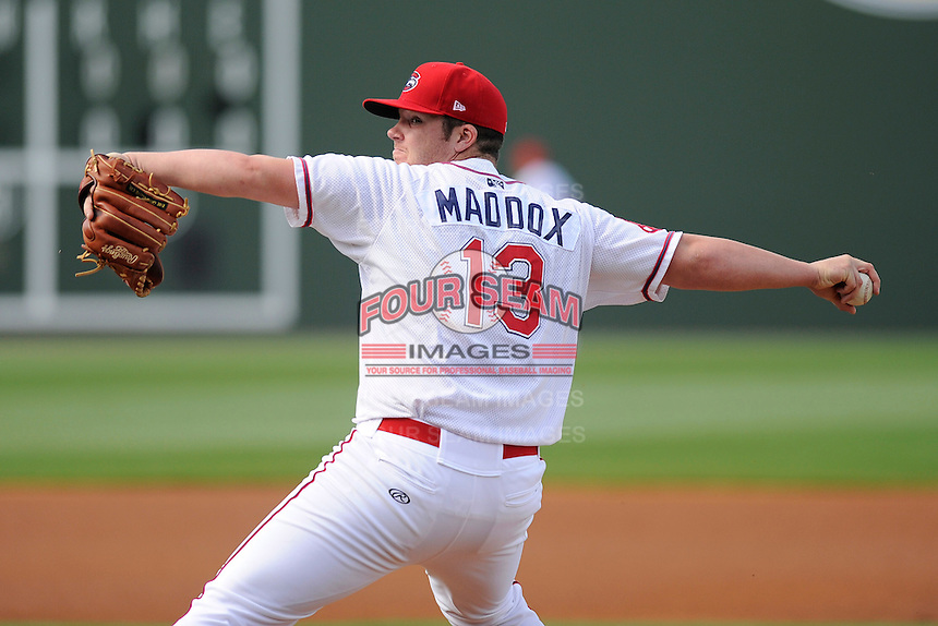 Pitcher Austin Maddox (13) of the Greenville Drive in a game against the Delmarva Shorebirds on Monday, April 29, 2013, at Fluor Field at the West End in Greenville, South Carolina. Maddox was selected by the Boston Red Sox in the 3rd Round of the 2012 First-Year Player Draft. Delmarva won, 6-5 in game one of a doubleheader. (Tom Priddy/Four Seam Images)