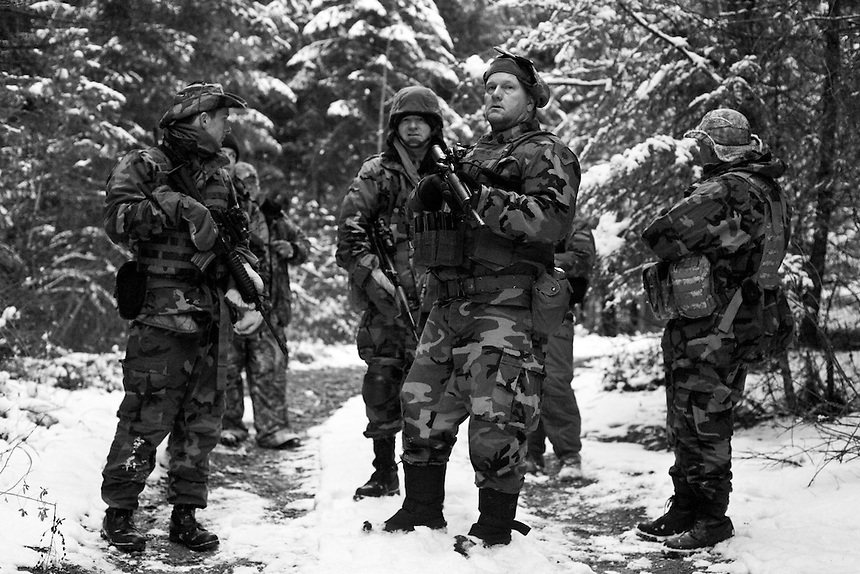 The 21st battalion of the Idaho Light Foot Militia stop to regroup during a training exercise in the Selkirk Mountains along the Idaho and Montana border.