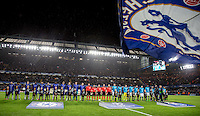The Teams line up as rain falls ahead of the match during the UEFA Champions League group G match between Chelsea and FC Porto at Stamford Bridge, London, England on 9 December 2015. Photo by Andy Rowland.