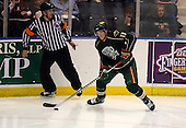 February 24th 2008:  Danny Irmen (19 ) of the Houston Aeros looks to pass in front of referee Jamie Koharski during a game vs. the Rochester Amerks at Blue Cross Arena at the War Memorial in Rochester, NY.  The Aeros defeated the Amerks 4-0.   Photo copyright Mike Janes Photography 2008