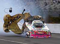 Mar 13, 2015; Gainesville, FL, USA; NHRA funny car driver Courtney Force during qualifying for the Gatornationals at Auto Plus Raceway at Gainesville. Mandatory Credit: Mark J. Rebilas-