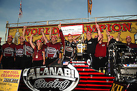 Nov 14, 2010; Pomona, CA, USA; NHRA top fuel dragster driver Larry Dixon (center) celebrates with his team after winning the 2010 top fuel championship during the Auto Club Finals at Auto Club Raceway at Pomona. Mandatory Credit: Mark J. Rebilas-