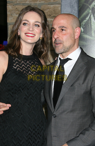 """Felicity Blunt, Stanley Tucci.""""Jack The Giant Slayer"""" Los Angeles Premiere held at Grauman's Chinese Theatre, Hollywood, California, USA..February 26th, 2013.half length black white shirt tie grey gray stubble facial hair sleeveless dress   married husband wife .CAP/ADM/RE.©Russ Elliot/AdMedia/Capital Pictures."""