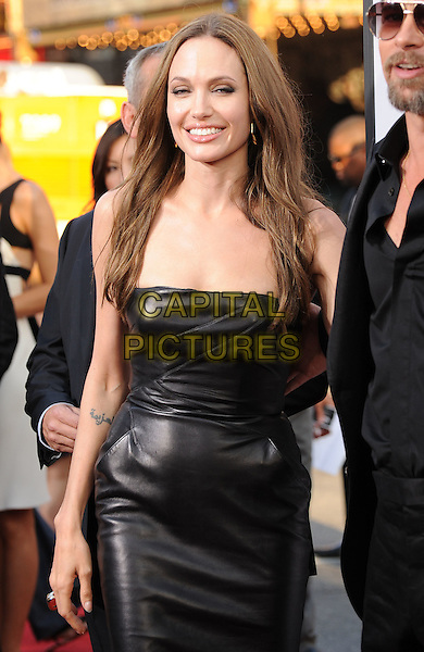 "ANGELINA JOLIE.The L.A. premiere of ""Inglourious Basterds"" held at The Grauman's Chinese Theatre in Hollywood, California on .August 10th, 2009 .half length black strapless leather dress tattoo.CAP/DVS.©Debbie VanStory/Capital Pictures."