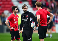 Lincoln City's assistant manager Nicky Cowley, centre, speaks to Tom Pett, left, and Mark O'Hara during the pre-match warm-up<br /> <br /> Photographer Andrew Vaughan/CameraSport<br /> <br /> The EFL Sky Bet League Two - Lincoln City v Macclesfield Town - Saturday 30th March 2019 - Sincil Bank - Lincoln<br /> <br /> World Copyright © 2019 CameraSport. All rights reserved. 43 Linden Ave. Countesthorpe. Leicester. England. LE8 5PG - Tel: +44 (0) 116 277 4147 - admin@camerasport.com - www.camerasport.com