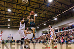 Paul Dick, Garvey's Tralee Warriors gets well up to score against League leaders Templeogue of Dublin at Tralee Sports complex last Saturday night.