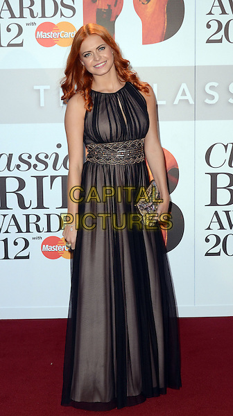 Sophie Evans.The Classic Brit Awards 2012, The Royal Albert Hall, London, England..2nd October 2012.full length black sheer sleeveless dress clutch bag waistband gold.CAP/WIZ.© Wizard/Capital Pictures.