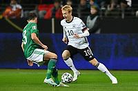 19th November 2019, Frankfurt, Germany; 2020 European Championships qualification, Germany versus Northern Ireland; Corry Evans (NIrl)  is taken on by Julian Brandt (Ger)