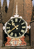 Delft, Netherlands - November 5, 2007 -- Close-up of the clock in the tower of the Oude Kerk (Old Church), the oldest Church in Delft, Netherlands.  It was built in 1246. Famous Dutchmen including Piet Hein, Maerten Tromp and Johannes Vermeer are buried in this church..Credit: Ron Sachs / CNP