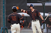 AZL Giants Black Jairo Pomares (16) is congratulated by Garrett Frechette (17) after scoring a run during an Arizona League game against the AZL Giants Orange on July 19, 2019 at the Giants Baseball Complex in Scottsdale, Arizona. The AZL Giants Black defeated the AZL Giants Orange 8-5. (Zachary Lucy/Four Seam Images)