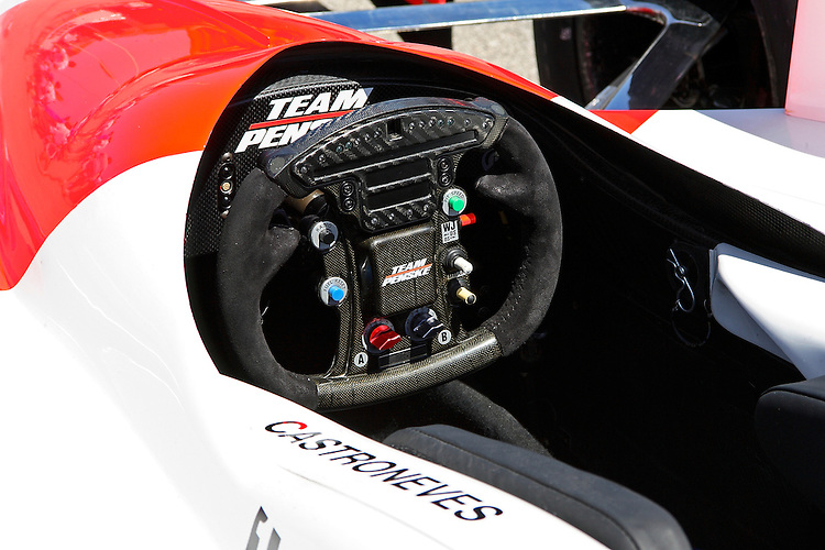 Helio Castroneves has little room to handle this small steering wheel in the Team Penske car at the IndyCar Series Kansas Lottery Indy 300 at Kansas Speedway in Kansas City, Kansas on April 29, 2007.
