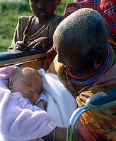 Anna's baby is held by Lemarti's grandmother