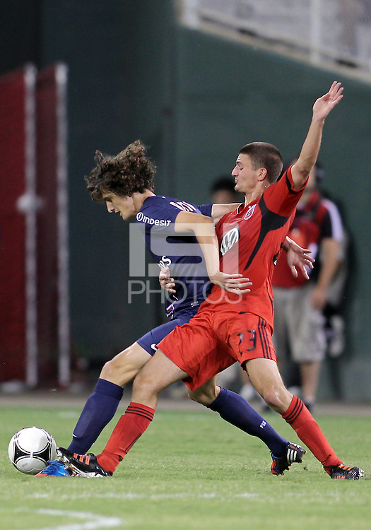WASHINGTON, DC - July 28, 2012:  Perry Kitchen (23) of DC United tackles Adrien Rabiot (31) of PSG (Paris Saint-Germain) in an international friendly match at RFK Stadium in Washington DC on July 28. The game ended in a 1-1 tie.