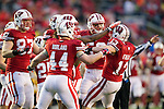 Wisconsin Badgers linebacker Conor O'Neill (13) celebrates a recovered fumble with teammates during an NCAA Big Ten Conference college football game against the Penn State Nittany Lions on November 26, 2011 in Madison, Wisconsin. The Badgers won 45-7. (Photo by David Stluka)
