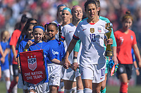 CHICAGO, IL - OCTOBER 06: Carli Lloyd #10 of the United States and a player escort during a game between the USA and Korea Republic at Soldier Field, on October 06, 2019 in Chicago, IL.