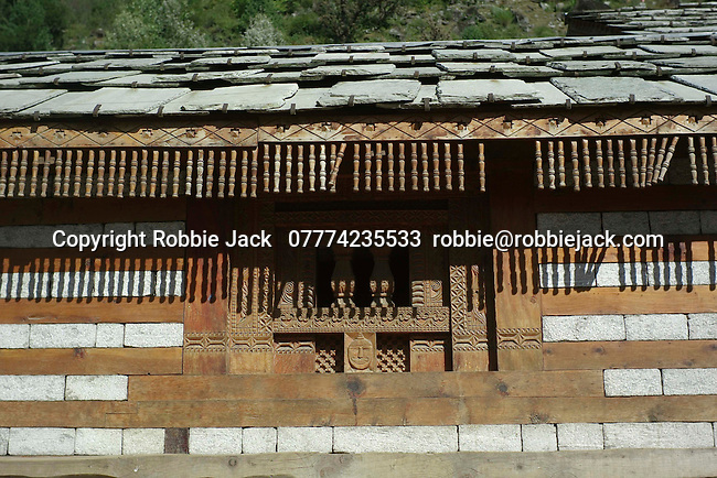 Part of the exterior wall  and roof of the Vashisht temple.Vashisht  was one of the Saptarishis (seven great sages) and spiritual master (guru) of Lord Rama..Vashisht, Kullu Valley  Himachal Pradesh, India.