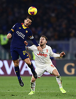 12th January 2020; Stadio Olympico, Rome, Italy; Italian Serie A Football, Roma versus Juventus; Alessandro Florenzi of AS Roma wins the header from Aaron Ramsey of Juventus