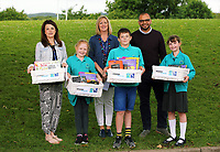 (L-R) Teacher Sarah-Lee Rees, third winner Gwen Lindsey-Jones, assistant head teacher Karen Armstrong, first winner Cai Jones, 9, Rav Raichura and second winner Caitlin Scotti 9.