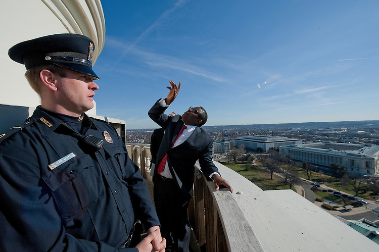 UNITED STATES - Dec 19: Project manager Eugene Poole of the AOC talks about work that will be done to the dome in the coming months with a view behind him to the South from the top of the US Capitol dome during a tour of the dome December 19, 2013 in Washington, DC. The Dome has not undergone a complete restoration since 1959-1960 and due to age and weather is now plagued by more than 1,000 cracks and deficiencies. The Architect of the Capitol began in November, a multi-year project to repair these deficiencies, restoring the Dome to its original, inspiring splendor.  (Photo By Douglas Graham/CQ Roll Call)