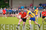 James O'Sullivan (Glencar) shields the ball as he moves forward with Ger Hartnett (Beaufort) keeping him company in the clash between the sides at Beaufort GAA grounds last Saturday evening..