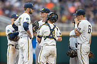 Michigan Wolverines pitching coach Chris Fetter (41) talks with Ben Keizer (14) against the Vanderbilt Commodores during Game 2 of the NCAA College World Series Finals on June 25, 2019 at TD Ameritrade Park in Omaha, Nebraska. Vanderbilt defeated Michigan 4-1. (Andrew Woolley/Four Seam Images)