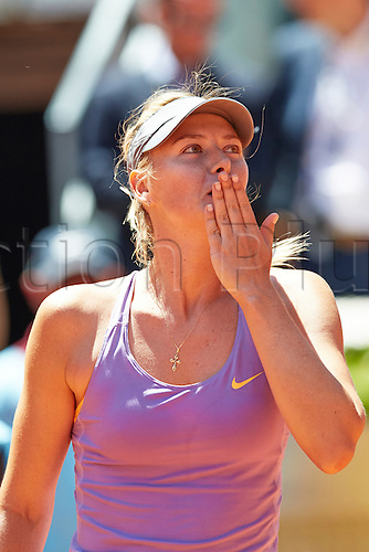 09.05.2014 Madrid, Spain. Maria Sharapova of Russia blows kisses to  the crowd after her victory over Li Na of China on day 6 of the Madrid Open from La Caja Magica.