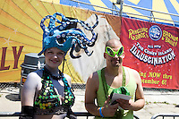 "Participants in the 2010 Mermaid Parade, which ""celebrates the sand, the sea, the salt air and the beginning of summer, as well as the history and mythology of Coney Island, Coney Island pride, and artistic self-expression."""