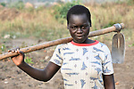 Phoebe Tumalu pauses as she and other members of the United Methodist Women in Yei, Southern Sudan, prepare a plot of land to plant vegetables as part of a group food security project. Many of them widows, the women live precariously but at peace after having returned from refugee camps in neighboring Uganda and the Congo in recent years. A 2005 Comprehensive Peace Agreement laid the foundations for peace in Sudan's south after decades of war. NOTE: In July 2011, Southern Sudan became the independent country of South Sudan