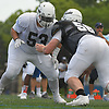 Kyle Nuñez #53, East Islip lineman, left, practices at Hofstra University on on Monday, June 19, 2017 in preparation for the 22nd annual Empire Challenge. The best seniors from Long Island will battle their New York City counterparts on Wednesday, June 21 at Shuart Stadium.