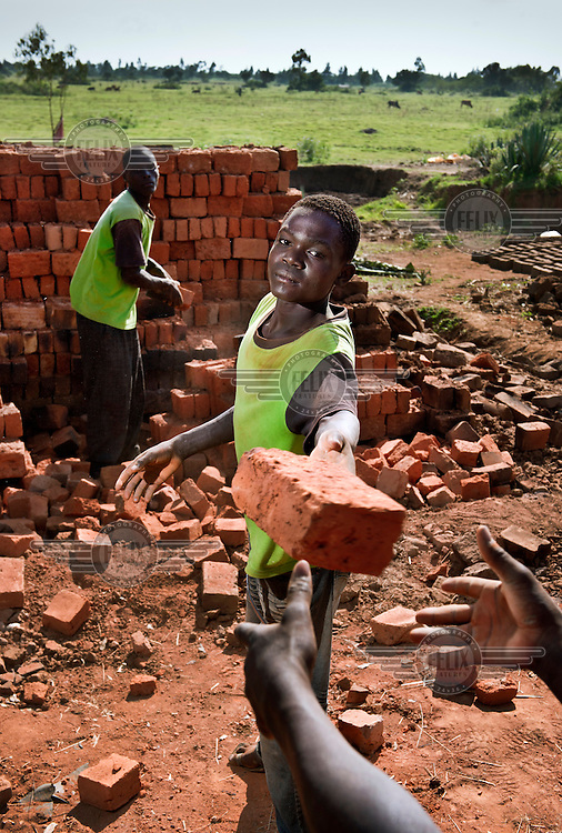 A portrait of 14 year old Charles, who works as a brick maker.