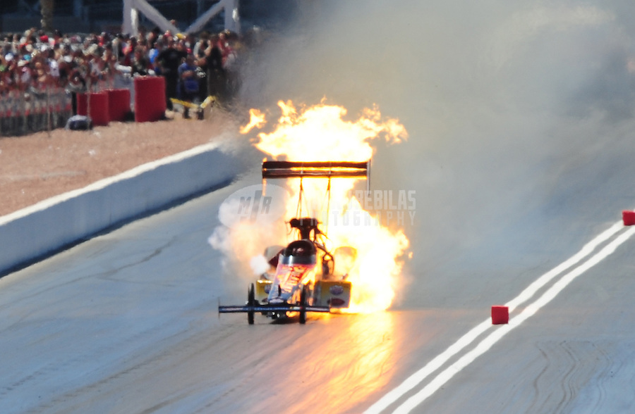 Apr. 13, 2008; Las Vegas, NV, USA: NHRA top fuel driver J.R. Todd explodes an engine in the first round of eliminations of the SummitRacing.com Nationals at The Strip in Las Vegas. Mandatory Credit: Mark J. Rebilas-
