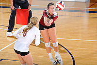 17 November 2011:  Denver outside hitter/defensive specialist Kate Acker (5) saves a shot in the second set as the FIU Golden Panthers defeated the Denver University Pioneers, 3-1 (25-21, 23-25, 25-21, 25-18), in the first round of the Sun Belt Conference Tournament at U.S Century Bank Arena in Miami, Florida.