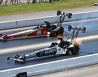 Jun 18, 2017; Bristol, TN, USA; NHRA top fuel driver Shawn Langdon (near) alongside Doug Kalitta during the Thunder Valley Nationals at Bristol Dragway. Mandatory Credit: Mark J. Rebilas-USA TODAY Sports