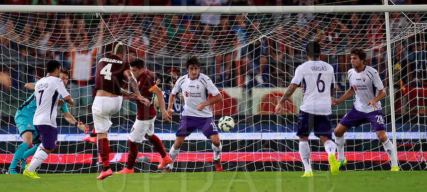 Calcio, Serie A: Roma vs Fiorentina. Roma, stadio Olimpico, 30 agosto 2014.<br /> Roma midfielder Radja Nainggolan, of Belgium, third from right, n. 4, kicks to score during the Italian Serie A football match between AS Roma and Fiorentina at Rome's Olympic stadium, 30 August 2014.<br /> UPDATE IMAGES PRESS/Isabella Bonotto