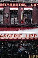 Brasserie Lipp during snowstorm, Paris, France