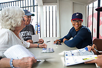 Northwest Arkansas Naturals outfielder Blake Perkins (44) signs autographs for fans on May 4, 2019, at Arvest Ballpark in Springdale, Arkansas. (Jason Ivester/Four Seam Images)