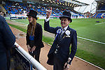 Peterborough United 1 Chesterfield 0, 21/03/2015. Abax Stadium, League One. Home club mascots known as Mr Posh and Miss Posh, chatting to spectators at the Abax Stadium, before Peterborough United play Chesterfield in a SkyBet League One fixture. The home team won the match by one goal to nil, watched by a crowd of 6,612. The result allowed Peterborough to leapfrog their opponents into the League One play-off positions with eight games remaining of the season. Photo by Colin McPherson.