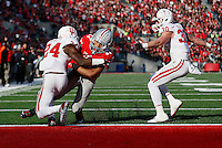 Ohio State Buckeyes running back Jalin Marshall (17) gets past Indiana Hoosiers cornerback Tim Bennett (24) to score a touchdown in the fourth quarter of the college football game between the Ohio State Buckeyes and the Indiana Hoosiers at Ohio Stadium in Columbus, Saturday afternoon, November 22, 2014. The Ohio State Buckeyes defeated the Indiana Hoosiers 42 - 27. (The Columbus Dispatch / Eamon Queeney)