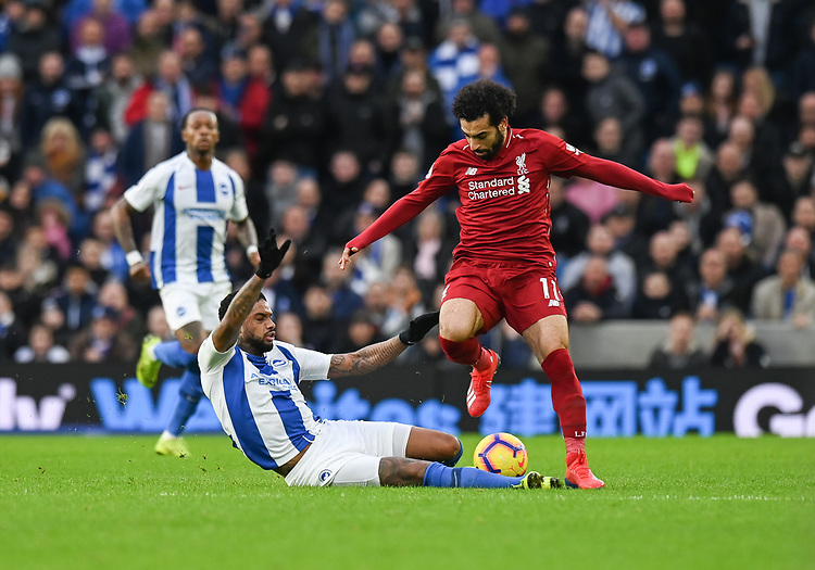 Brighton & Hove Al\\lbion's Jurgen Locadia (left) vies for possession with Liverpool's Mohamed Salah (right) <br /> <br /> Photographer David Horton/CameraSport<br /> <br /> The Premier League - Brighton and Hove Albion v Liverpool - Saturday 12th January 2019 - The Amex Stadium - Brighton<br /> <br /> World Copyright © 2018 CameraSport. All rights reserved. 43 Linden Ave. Countesthorpe. Leicester. England. LE8 5PG - Tel: +44 (0) 116 277 4147 - admin@camerasport.com - www.camerasport.com