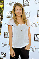 "TV Personality Nicole Richie attends the ""Bing Summer Of Doing"" with Dosomething.org by restoring CITYarts Mosaic Peace Wall at the Jacob H. Schiff Playground on July 10, 2012 in New York City. © mpi81 / MediaPunch Inc."