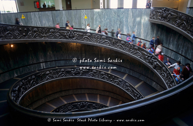 Tourists climbing the spiral staircase at the Vatican Museums, Vatican City, Rome, Italy.
