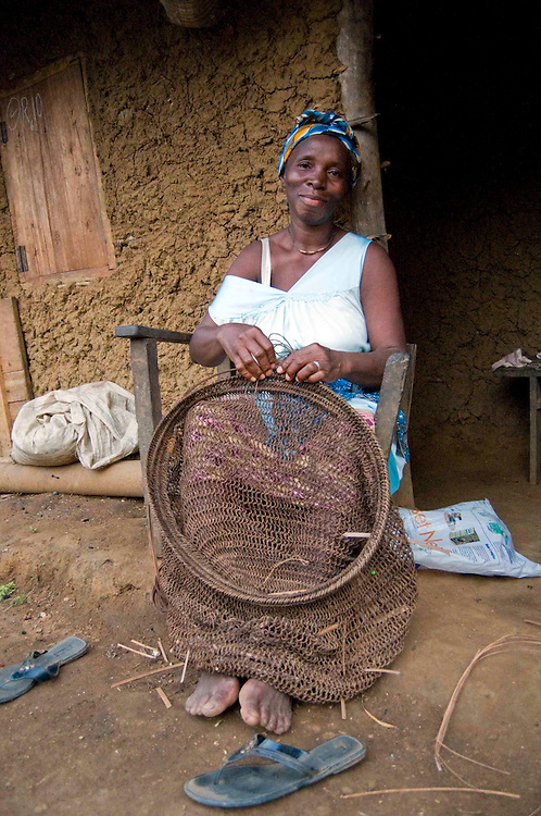 A woman (the Chief's wife) makes a fishing net in the village of Lalehun