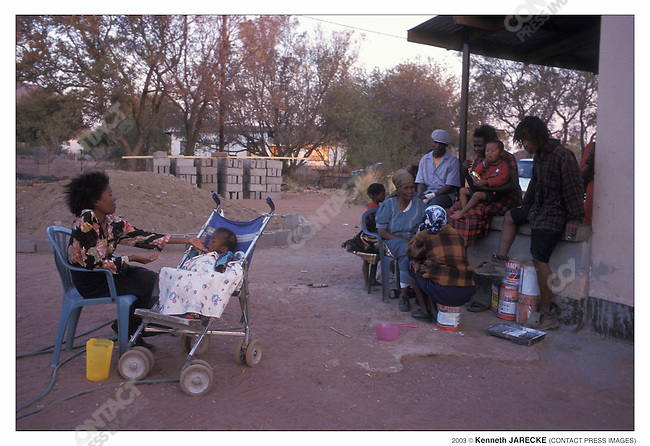 """This woman and her baby (whose nickname, Radithobade, means """"stick"""") are HIV-positive but have not been able to find reliable transportation to get the drugs that could extend their lives. Otse, Botswana, September 2003...2003 © Kenneth JARECKE (CONTACT Press Images) ."""