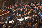 Republicans stand and applaud while Democrats sit as United States President Donald J. Trump delivers his first State of the Union address to a joint session of the US Congress in the US House chamber in the US Capitol in Washington, DC on Tuesday, January 30, 2018.<br /> Credit: Ron Sachs / CNP<br /> (RESTRICTION: NO New York or New Jersey Newspapers or newspapers within a 75 mile radius of New York City)