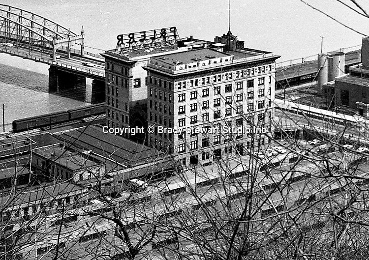 Pittsburgh PA: View of the P&LERR (Pennsylvania and Lake Erie Railroad) building and yard on the south side next to the Smithfield Street Bridge - 1962.  Formed in 1875, the P&LERR served the steel, coke, coal and iron ore industries in and around Pittsburgh.  With the decline of the industries during the 1980s, the railroad ceased operations in 1993.