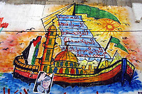 """A mural of a """"Hamas ship"""" is seen in the front of a Hamas mosque in the refugee camp of Khan Junis, Gaza. The mural contains a map of """"Palestine"""" (includes the whole Israel) painted with the Palestinian flag, the holy mosque of Al Aqsa, and a sail with Hamas  slogans: """"God is its destination"""", The Prophet is its example"""", """"the Koran is its constitution"""", """"Jihad is its path"""", """"Death for the sake of Good is its most sublime wish"""". Photo by Quique Kierszenbaum"""
