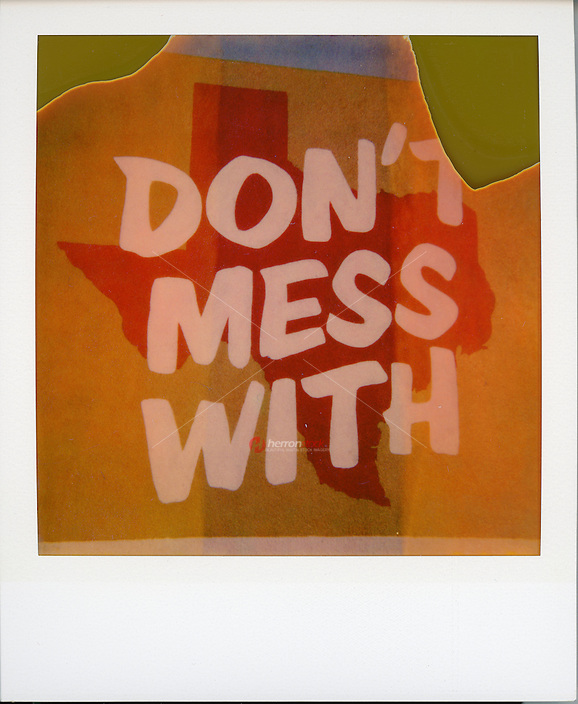 "Polaroid instant picture shot on expired Polaroid 600 film of ""Don't mess with Texas"" mural in downtown Austin, Texas - Stock Image."