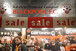 Fans inside the club shop at Blackpool FC's Bloomfield Road stadium before the club played host to Liverpool FC in a Premier League match. The home side won by two goals to one. It was the first time the clubs had met in a league match since Blackpool were last in the top division of English football in 1970-71.